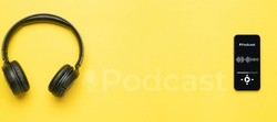 Podcast audio equipment. Audio microphone, sound headphones, podcast application on mobile smartphone screen. Recording sound voice on yellow background. Live online radio player mockup banner
