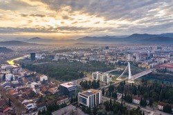 Podgorica Montenegro: Beautiful sunset over the downtown including Moraca river and Millennium bridge, the famous landmark. Aerial view.
