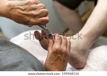 podologist gives a medical treatment at home