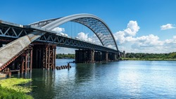 Podolsky bridge, panoramic view of the bridge under construction across the Dnieper, clear weather, summer