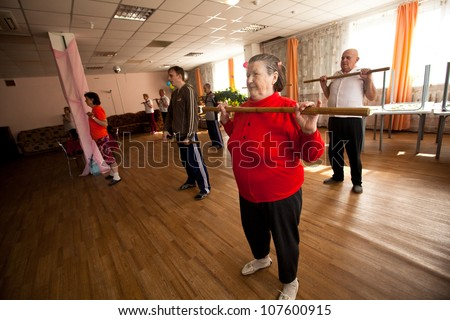 PODPOROZHYE, RUSSIA - JULY 5: Day of Health in Center of social services for pensioners and the disabled Otrada (gymnastics with sticks for eldery and disabled), July 5, 2012 in Podporozhye, Russia.