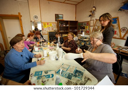 PODPOROZHYE, RUSSIA - MAY 4: Day of Health in Center of social services for pensioners and disabled Otrada (occupational therapy for eldery), May 4, 2012 in Podporozhye, Russia.