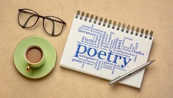poetry word cloud - handwriting in a spiral sketchbook with a cup of coffee against textured bark paper, art, literature, storytelling  and creativity concept