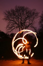 Poi performance with fire and pattern