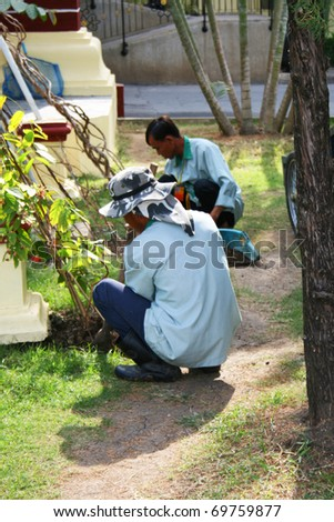 POI PET, THAILAND - JANUARY 19: Men working at a resort at Poi Pet on January 19, 2011 in Thailand.