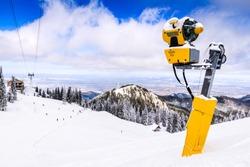 Poiana Brasov, Romania - Snow cannon on ski slopes resort in Carpathian Mountains.