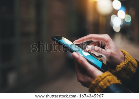 point finger on screen mobile phone closeup, person texting text message, hipster touch blue screen on smartphone light night city, girls using in hands cellphone close up, online internet