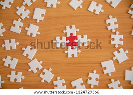 point holding connecting red and White ,Business connection,Success and strategy concept one finger , point pieces of jigsaw puzzle,Teamwork concept #1124729366
