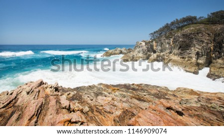 Point Lookout Gorge on North Stradbroke Island. Big Waves crashing on rock walls during a king tide in Summer. Queensland, 2018 stock photo