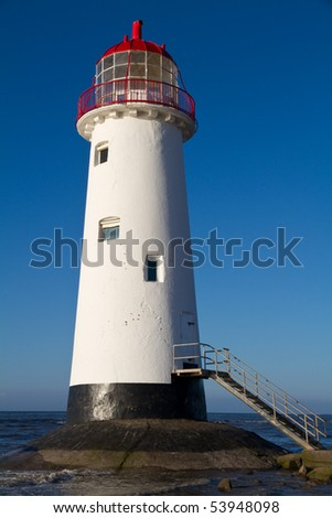 Point of Ayr Lighthouse, Wales UK  with an incoming tide at sunset