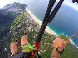 Point of view from paragliding pilot over Rio de Janeiro beach, Brazil
