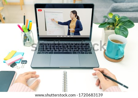 Point of view of young asian girl sit on desk and learn at home living room in concept of romote learning, virtual online, self isolated quarantine lifestyle in asia. Teaching video call on computer.