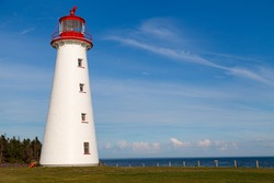 Point Prim Light House, Prince Edward Island, Canada, a National Heritage site, is the first and oldest lighthouse on the island, the historic round brick structure is now covered with wooden shingles