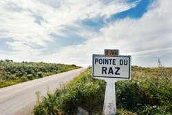 Pointe du Raz signal indication on the road. A rocky, dangerous point that extends into the Atlantic from western Brittany, France.