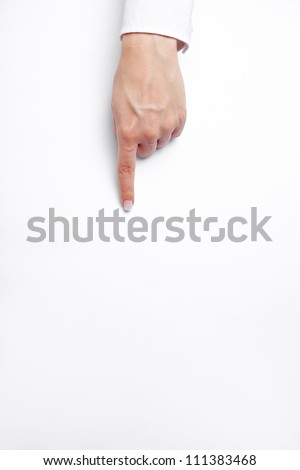 Pointed index finger on a piece of white paper