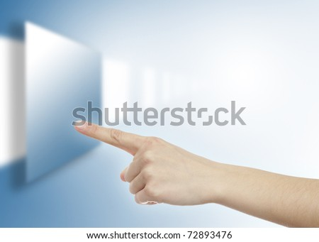 Pointer finger touching virtual screen - stock photo