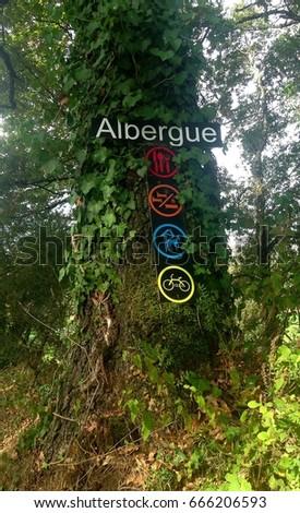Pointer of pilgrim's spanish hostel on the tree. #666206593