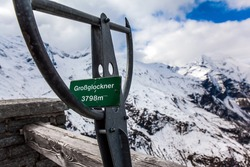 Pointer to the highest peak of the Alps - Grossglockner - 3798 meters. The first snow fell on Grossglockner Alpine Road. Austria. Ecological, active and photo tourism concept