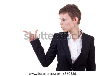 Pointing and looking to the side. Casual young business woman looking, pointing and smiling at copy space.
