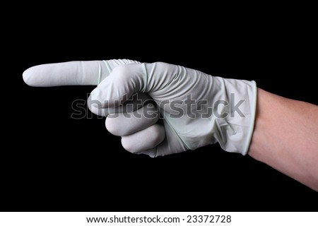 Pointing hand in medical glove