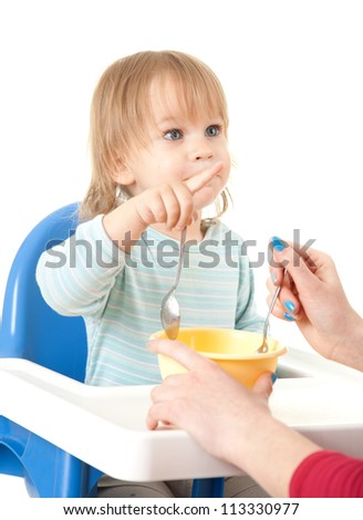 pointing little boy feeding by his mother, white background