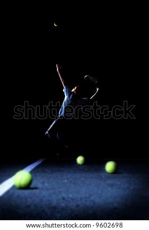 Poise and Focus- A Teenager Practicing His Tennis Serve