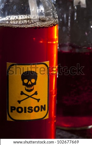 Poison bottle with label