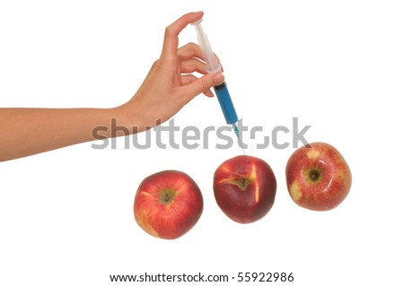 Poison in a syringe is injected into apples