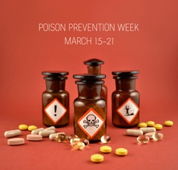 Poison Prevention Week. Brown bottle with warning pictogram stock images. Toxic drug on a red background stock images. Vial with poison. Poison Prevention Week Poster, March 15-21