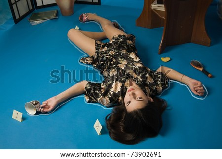 Poisoned brunette in a dressing gown lying on the floor