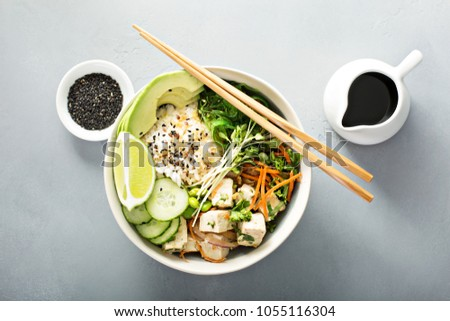 Poke bowl with silken tofu, seaweed, rice and vegetables