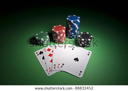 Poker cards and chips on green background close up