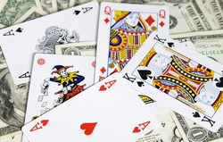 Poker cards on dollar banknotes
