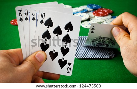 Poker cards on green table