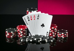 Poker cards with five of a kind the highest combination. Close-up of playing cards and chips in casino. Free advertising space