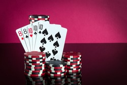 Poker cards with full house or full boat combination. Close-up of playing cards and chips in poker club. Free advertising space