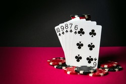 Poker cards with straight flush combination. Close-up of playing cards and chips in poker club. Free advertising space