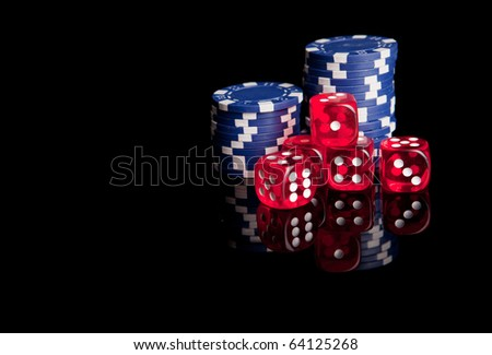 Poker chips and dices, isolated over black background