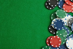 Poker chips forming a border on the right with a green  background
