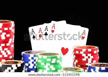 Poker chips isolated on a black background.