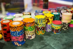 Poker chips on a table in casino.