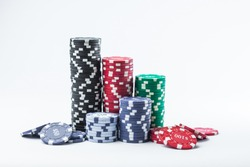 Poker chips on a white background different stacks of isolate