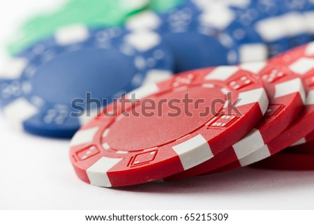 Poker chips on a white background. Small DOF.