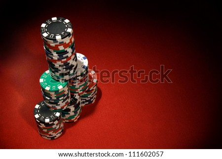 Poker chips on red background