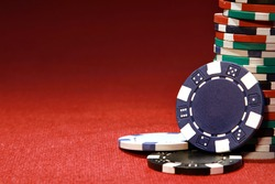 Poker chips on red background with place for sample text