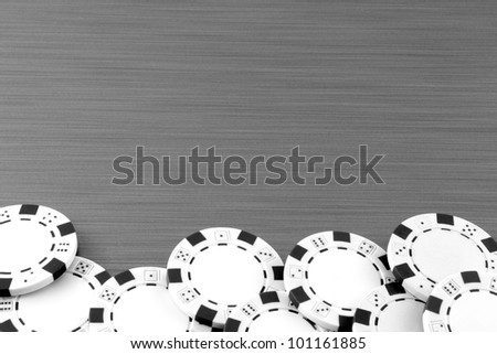 Poker chips on stainless steel background