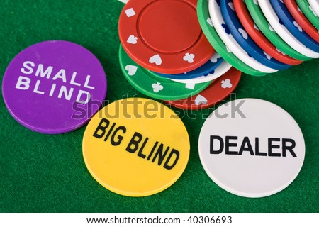 Poker chips showing small blind, big blind and dealer