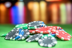Poker chips with blur background on table in casino