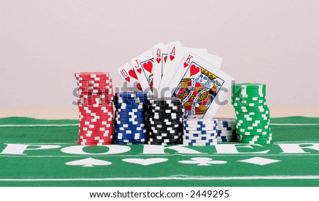 Poker Chips With Cards poker chips in five different colors on a table with cards.