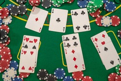 poker chips  with play cards on the green casino table. gambling